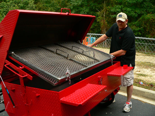 Flipping a pig or a grill full of chicken is easy with our Double Grate Turner.