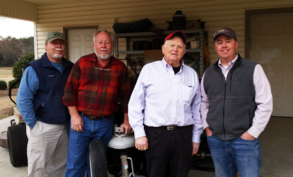 New owners of a Carolina Pig Cookers grill, in Lumberton, North Carolina.