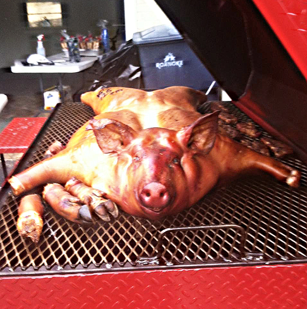 Whole hog cooking on the Carolina Pig Cookers grill.