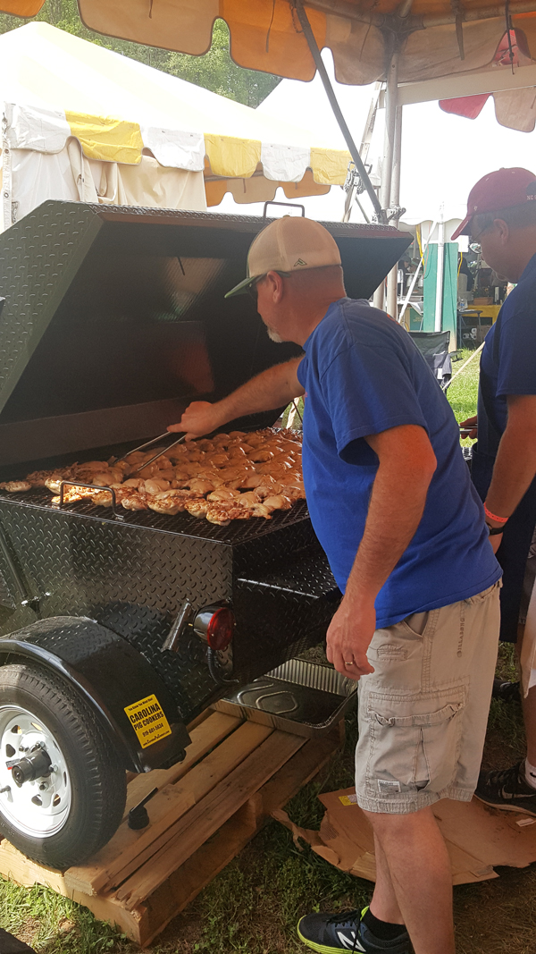 Merlefest, cooking on a Carolina Pig Cookers grill.