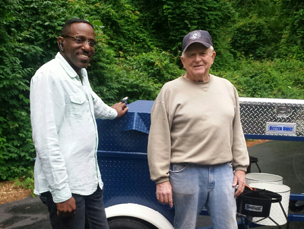 Garfield, from Raleigh, with his new Carolina Pig Cookers grill.