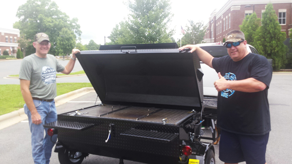 Waxhaw Police Department, new owners of a Carolina Pig Cookers grill.