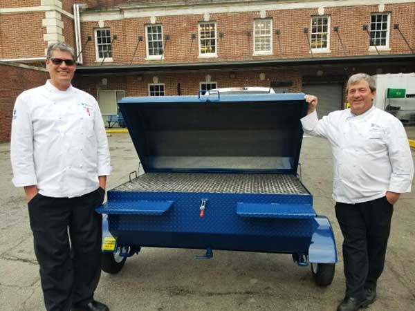Duke Dining Services with their new Carolina Pig Cookers grill.