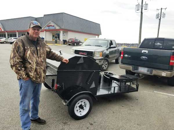 Bobby W. with his new Carolina Pig Cookers grill.